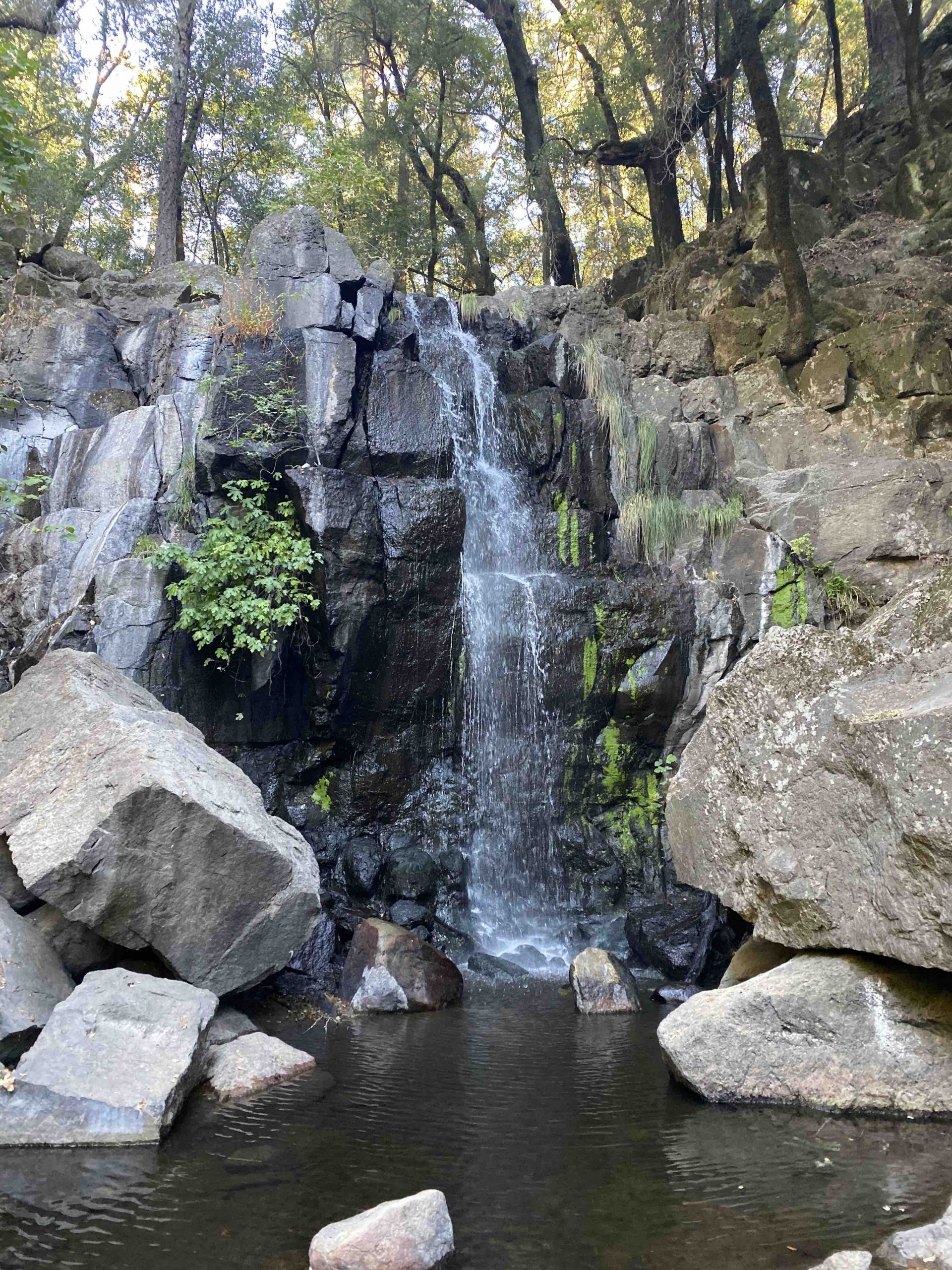 waterfall as destination on a walk during the divine hustler retreat with Laura Martin Bovard